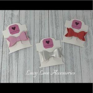 Handmade set of three leather bow hair clips!